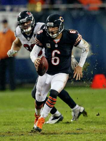Chicago Bears quarterback Jay Cutler (6) scrambles away from a Houston Texans defender in the first half an NFL football game, Sunday, Nov. 11, 2012, in Chicago. (AP Photo/Charles Rex Arbogast) Photo: Charles Rex Arbogast, Associated Press / AP
