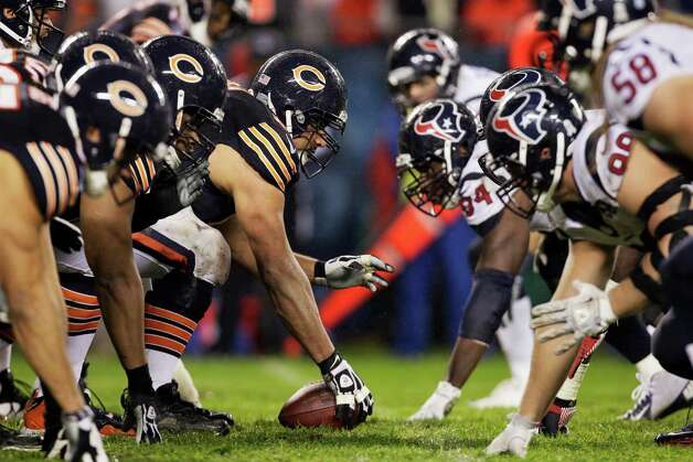 Chicago Bears  and Houston Texans players prepare for a play at the line of scrimmage in the first half an NFL football game in Chicago, Sunday, Nov. 11, 2012. (AP Photo/Nam Y. Huh) Photo: Nam Y. Huh, Associated Press / AP