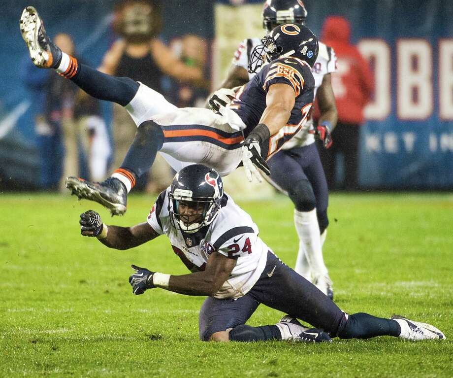 Bears running back Matt Forte (22) is upended by Texans cornerback Johnathan Joseph (24) in the second quarter Sunday night in Chicago. Photo: Smiley N. Pool, Staff / © 2012  Houston Chronicle