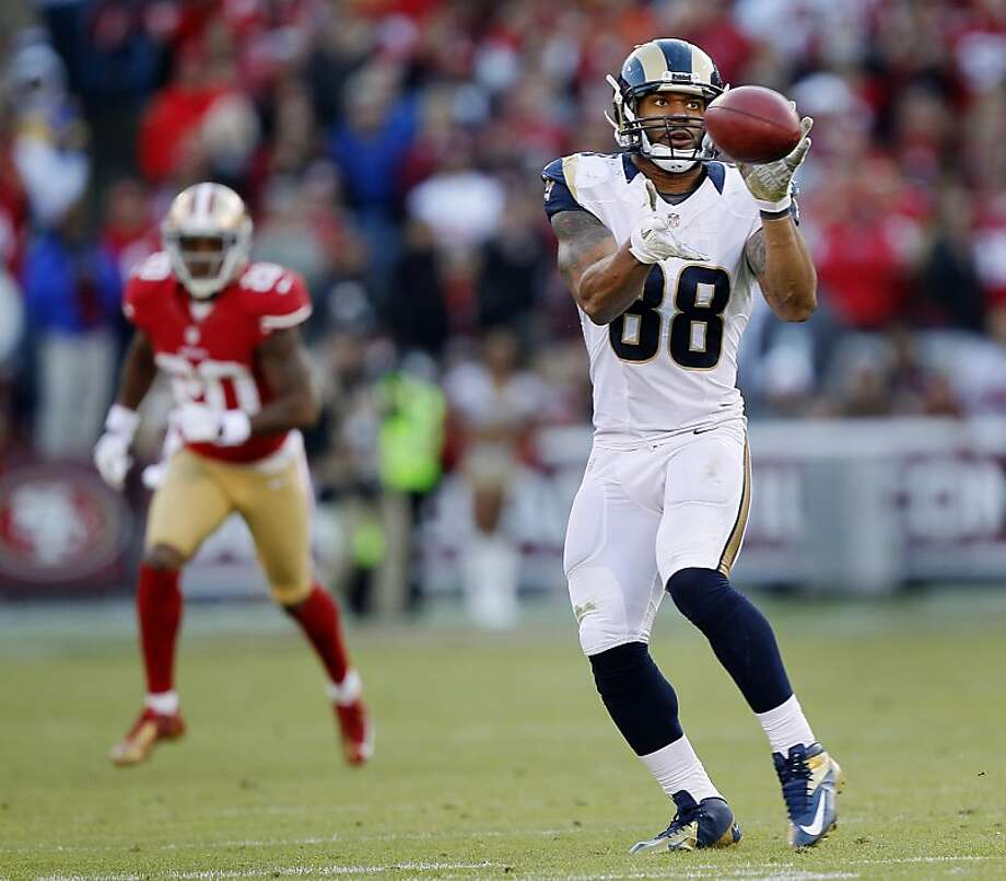 Lance Kendricks' 19-yard reception of a pass from punter Johnny Hekker contributes to the Rams' 81-yard go-ahead drive in the fourth quarter. Photo: Brian Bahr, Getty Images
