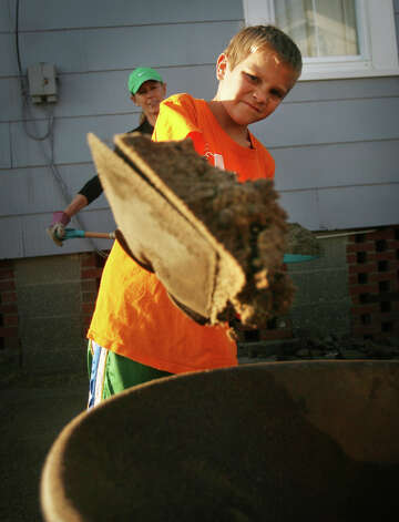 Max Yates, 10 of Fairfield, participates in a large volunteer beach cleanup effort on Fairfield Beach Road in Fairfield on Sunday, November 11, 2012. Photo: Brian A. Pounds / Connecticut Post