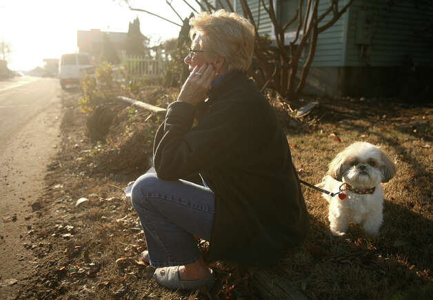 Melissa Barnes and her dog Gigi sit outside her home on Fairfield Beach Road in Fairfield on Sunday, November 11, 2012. Photo: Brian A. Pounds / Connecticut Post