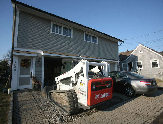 The new normal? A Bobcat is parked in the driveway of a home on Fairfield Beach Road in Fairfield on Sunday, November 11, 2012. Photo: Brian A. Pounds / Connecticut Post