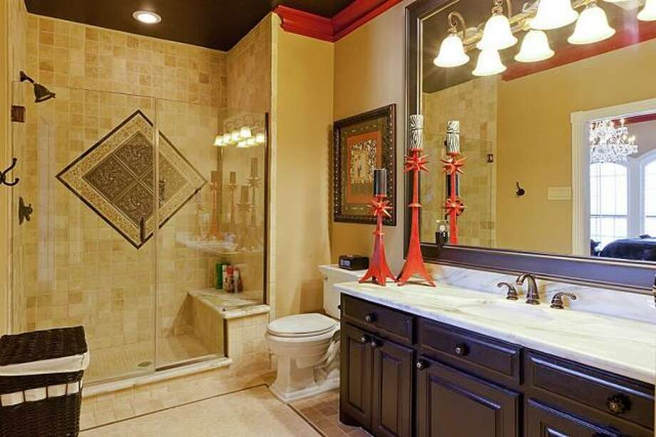 This bathroom has a large vanity and solid wood cabinets. Photo: Better Homes And Gardens Gary Greene
