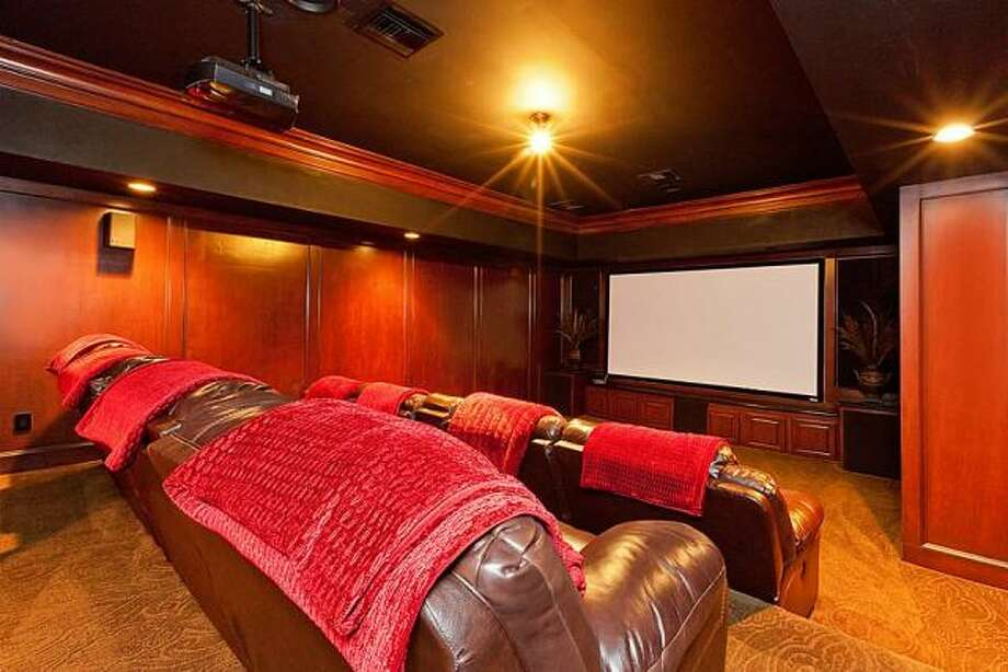 The home theater is perfect for entertaining. Photo: Better Homes And Gardens Gary Greene
