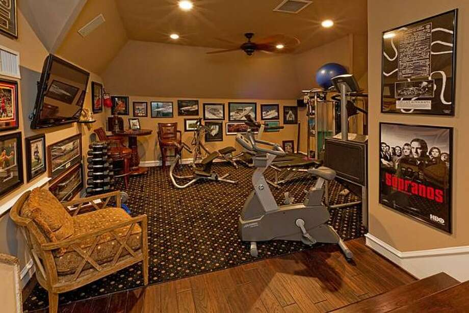 This additional room can be used as an exercise space or game room. Photo: Better Homes And Gardens Gary Greene