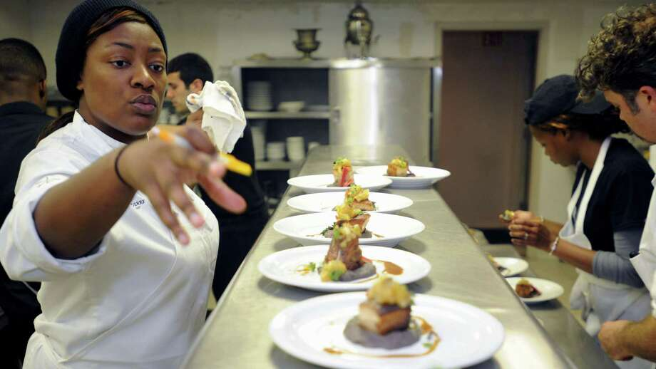 Top Chef star Tiffany Derry organizes dishes and workers in the Beaumont Club kitchen during her pop-up restaurant Friday night. Derry commented that she hopes to have a restaurant in Beaumont within a year.  Photo taken Friday, November 9, 2012 Guiseppe Barranco/The Enterprise Photo: Guiseppe Barranco, STAFF PHOTOGRAPHER / The Beaumont Enterprise