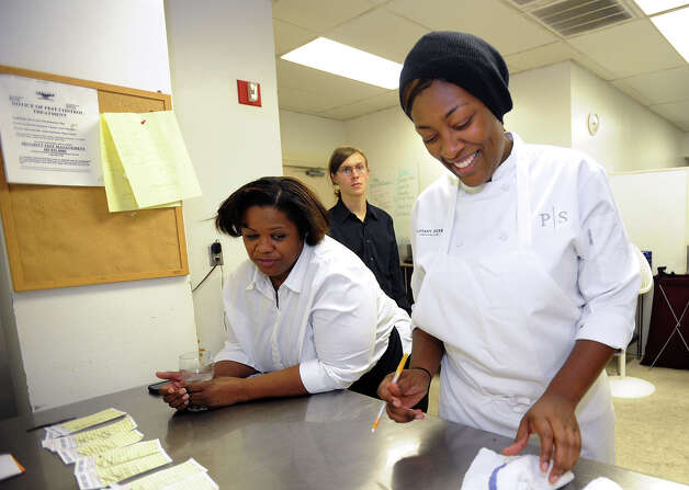 Tiffany Derry shares a laugh with Mary Brown in the kitchen at Derry's pop-up restaurant on Friday. Photo taken Friday, November 9, 2012 Guiseppe Barranco/The Enterprise Photo: Guiseppe Barranco, STAFF PHOTOGRAPHER / The Beaumont Enterprise