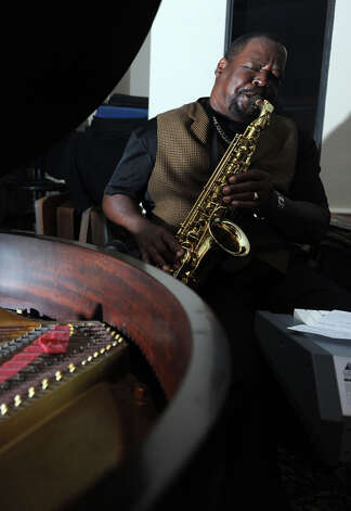 Lloyd Austin plays sax during Tiffany Derry's pop-up restaurant on Friday. Photo taken Friday, November 9, 2012 Guiseppe Barranco/The Enterprise Photo: Guiseppe Barranco, STAFF PHOTOGRAPHER / The Beaumont Enterprise