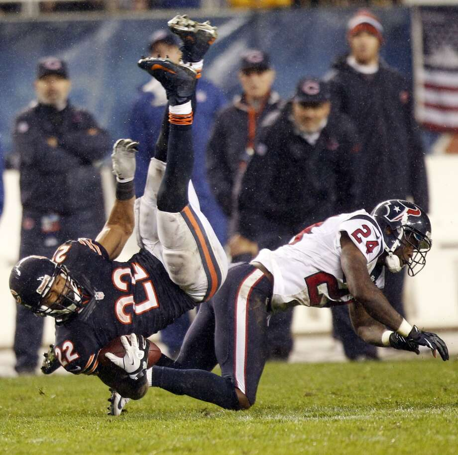 Bears running back Matt Forte (22) is upended by Texans cornerback Johnathan Joseph (24) during the second quarter. (Brett Coomer / Houston Chronicle)