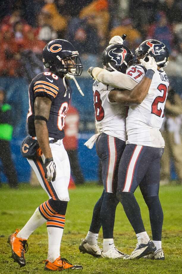Texans defensive back Quintin Demps (27) and free safety Danieal Manning (38) celebrate as Bears wide receiver Earl Bennett (80) walks off the field after the Texans stopped the Bears last fourth down attempt during the fourth quarter. (Smiley N. Pool / Houston Chronicle)