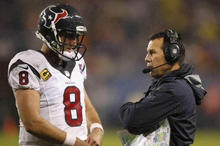 Texans head coach Gary Kubiak confers with quarterback Matt Schaub (8) during the second quarter. (Brett Coomer / Houston Chronicle)