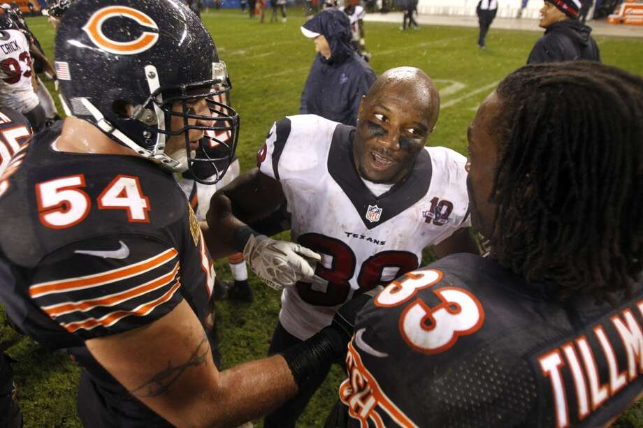 Texans free safety Danieal Manning (38) greets former teammates Bears middle linebacker Brian Urlacher (54) and  cornerback Charles Tillman (33) after the Texans win. (Brett Coomer / Houston Chronicle)
