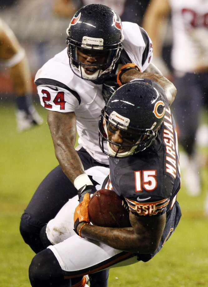 Bears wide receiver Brandon Marshall (15) make sa catch as Houston Texans cornerback Johnathan Joseph (24) defends during the second quarter. (Brett Coomer / Houston Chronicle)