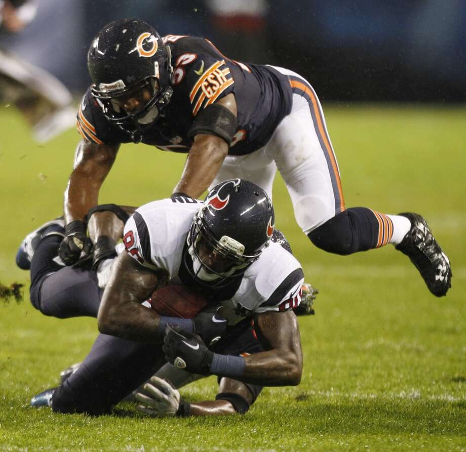 Texans wide receiver Andre Johnson (80) is brought down by Chicago Bears cornerback Charles Tillman (33) and outside linebacker Nick Roach (53) during the first quarter. (Brett Coomer / Houston Chronicle)