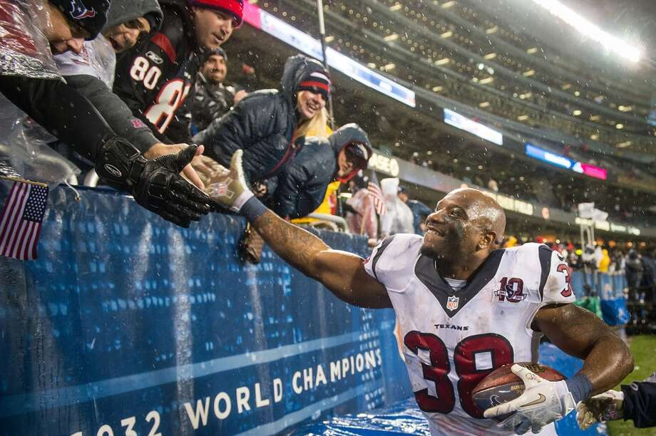 Texans free safety Danieal Manning high-fives fans as he leaves the field after the Texans 13-6 victory over the Bears at Soldier Field. (Smiley N. Pool / Houston Chronicle)