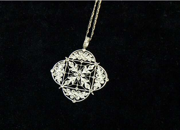 A platinum and diamond necklace recovered from the Titanic is seen in an image made from video. This piece and others begin a three-city tour in Atlanta on Friday, Nov. 16, 2012 and represent the largest collection of jewelry ever on display marking the 100th anniversary of the sinking of the ship. Although single pieces of jewelry have been on display at one or more permanent and traveling exhibits sponsored by Premier Exhibitions Inc., their Atlanta debut is the first time the majority of the collection has been available to the public. (AP Photo/Jpohnny Clark) Photo: Johnny Clark