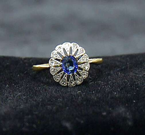 A diamond and sapphire ring recovered from the Titanic is seen in an image made from video. This piece and others begin a three-city tour in Atlanta on Friday, Nov. 16, 2012 and represent the largest collection of jewelry ever on display marking the 100th anniversary of the sinking of the ship. Although single pieces of jewelry have been on display at one or more permanent and traveling exhibits sponsored by Premier Exhibitions Inc., their Atlanta debut is the first time the majority of the collection has been available to the public. (AP Photo/Johnny Clark) Photo: Johnny Clark