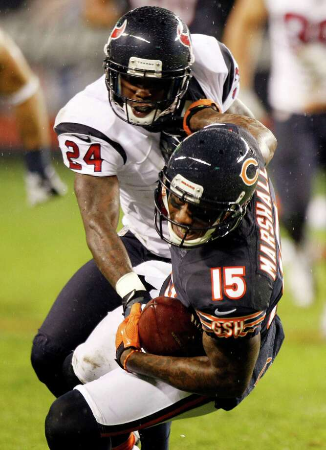 Bears wide receiver Brandon Marshall (15) make sa catch as Houston Texans cornerback Johnathan Joseph (24) defends during the second quarter. Photo: Brett Coomer, Houston Chronicle / © 2012  Houston Chronicle