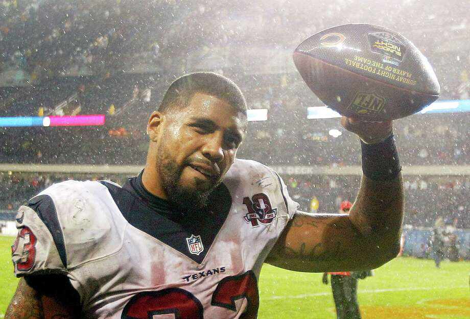 "Texans running back Arian Foster waves the ""Player of the Game"" football to the fans as he leaves the field after the Texans beat the Bears. Photo: Brett Coomer, Houston Chronicle / © 2012  Houston Chronicle"
