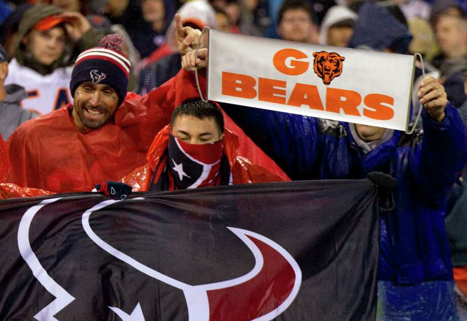 Texans fans vie for attention with Bears fans during the first quarter. Photo: Brett Coomer, Houston Chronicle / © 2012  Houston Chronicle