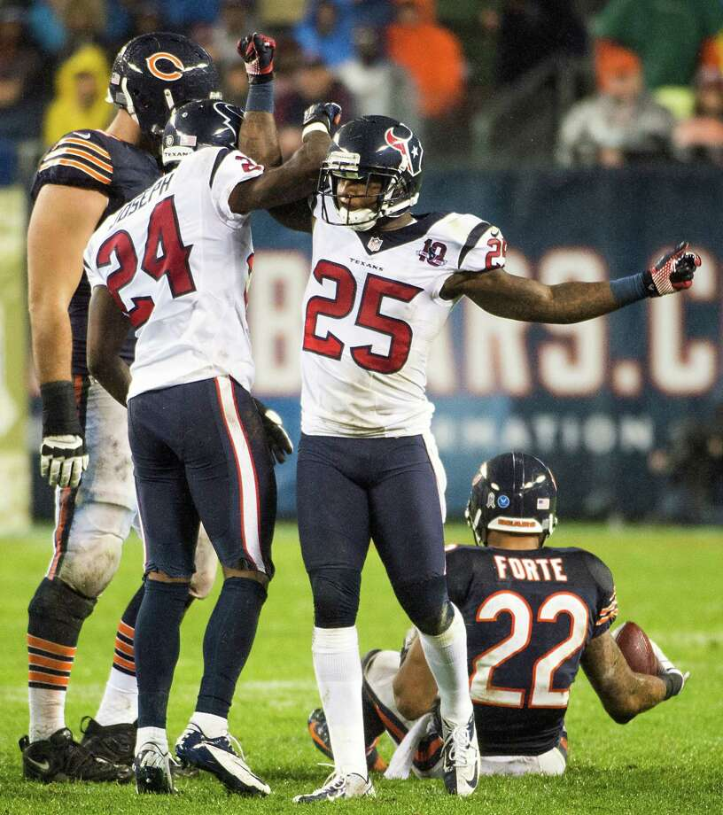 Texans cornerback Johnathan Joseph (24) and cornerback Kareem Jackson (25)] celebrate a stop on Chicago Bears running back Matt Forte (22) during the second quarter. Photo: Smiley N. Pool, Houston Chronicle / © 2012  Houston Chronicle