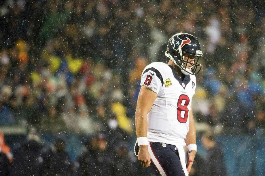 Texans quarterback Matt Schaub (8) brings in a play as rain falls during the first quarter. Photo: Smiley N. Pool, Houston Chronicle / © 2012  Houston Chronicle