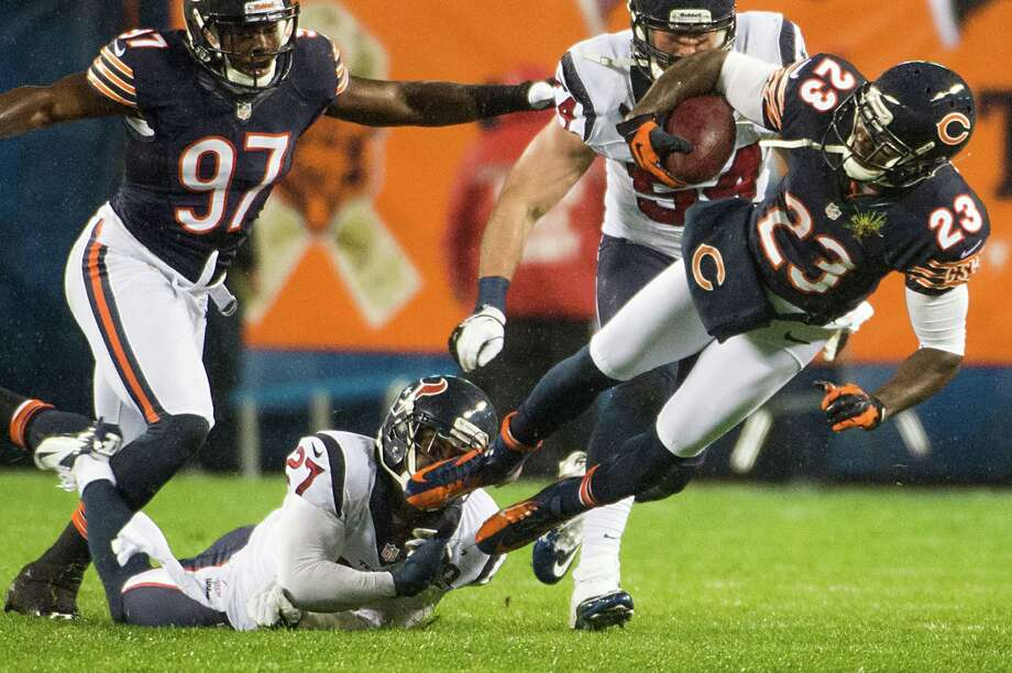 Bears kick returner Devin Hester (23) is brought down by the Houston Texans Quintin Demps (27) on a punt return during the first quarter. Photo: Smiley N. Pool, Houston Chronicle / © 2012  Houston Chronicle