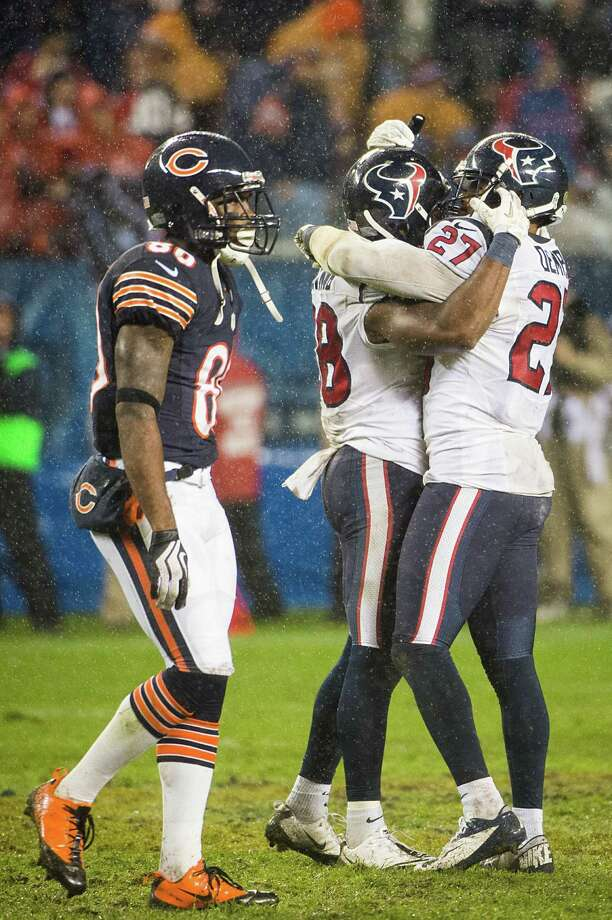 Texans defensive back Quintin Demps (27) and free safety Danieal Manning (38) celebrate as Bears wide receiver Earl Bennett (80) walks off the field after the Texans stopped the Bears last fourth down attempt during the fourth quarter. Photo: Smiley N. Pool, Houston Chronicle / © 2012  Houston Chronicle