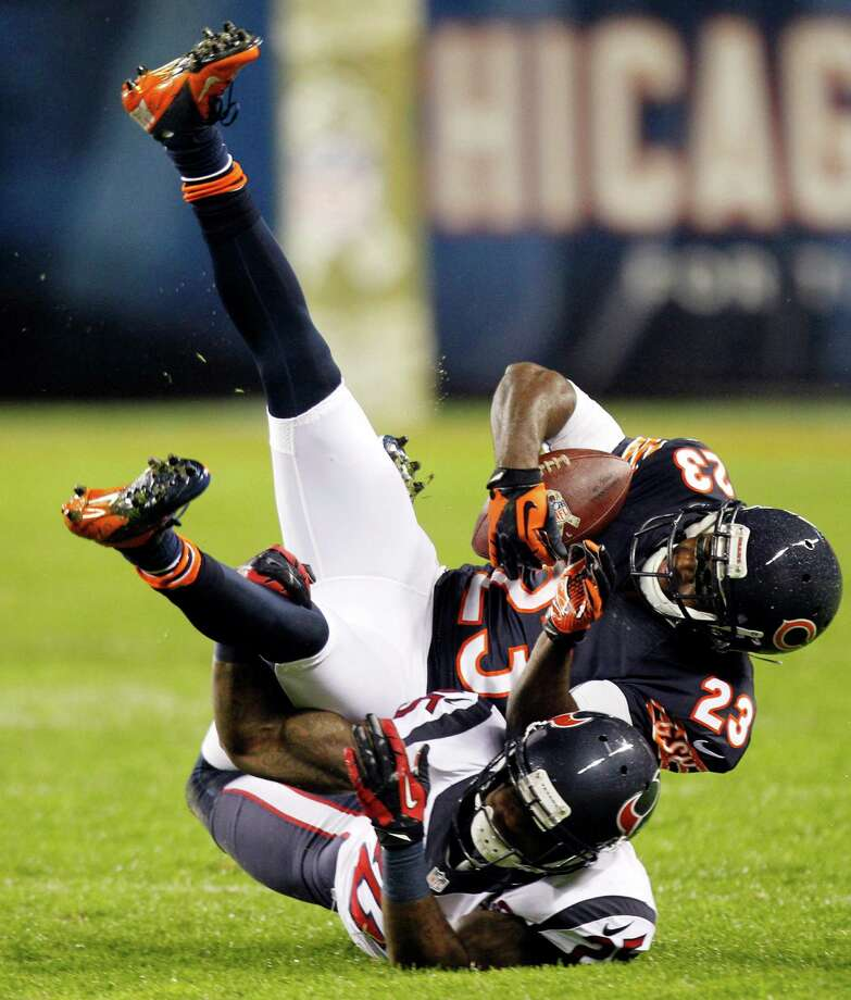 Bears wide receiver Devin Hester (23) is upended by Texans cornerback Kareem Jackson (25) during the second quarter. Photo: Brett Coomer, Houston Chronicle / © 2012  Houston Chronicle