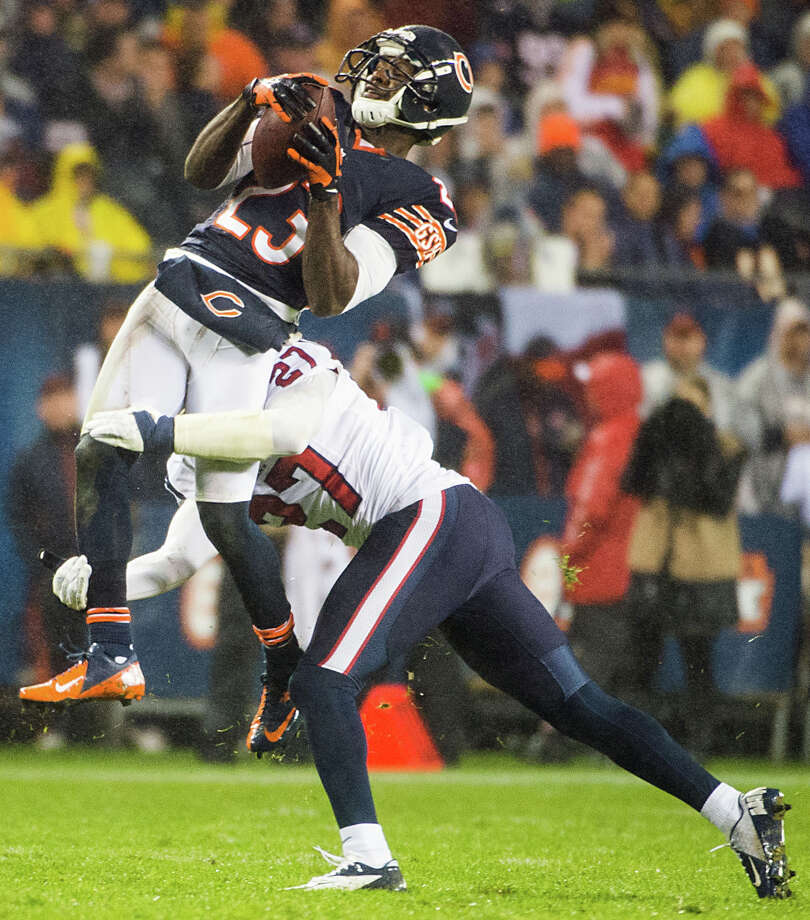 Chicago Bears wide receiver Devin Hester (23) makes a catch as he is hit by Houston Texans defensive back Quintin Demps (27) during the second quarter. Photo: Smiley N. Pool, Houston Chronicle / © 2012  Houston Chronicle