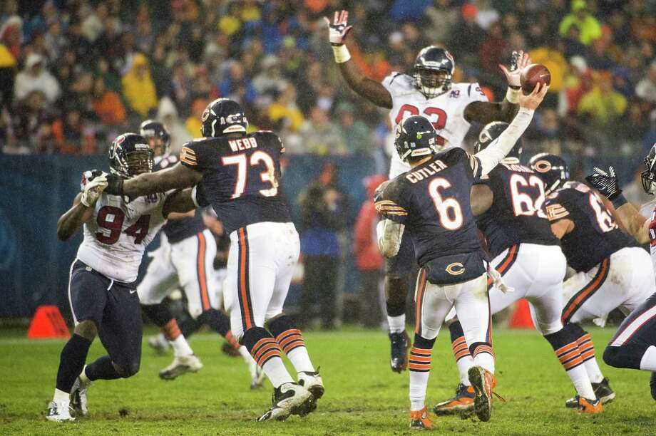 Bears quarterback Jay Cutler (6) throws over Houston Texans defensive tackle Earl Mitchell (92) only to be intercepted by cornerback Kareem Jackson during the second quarter. Photo: Smiley N. Pool, Houston Chronicle / © 2012  Houston Chronicle