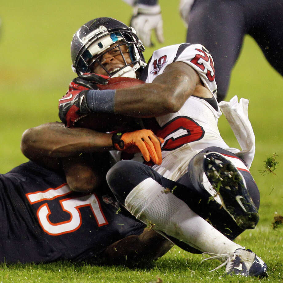 Texans cornerback Kareem Jackson (25) wrestles the ball away from Bears wide receiver Brandon Marshall (15) for an interception during the second quarter. Photo: Brett Coomer, Houston Chronicle / © 2012  Houston Chronicle