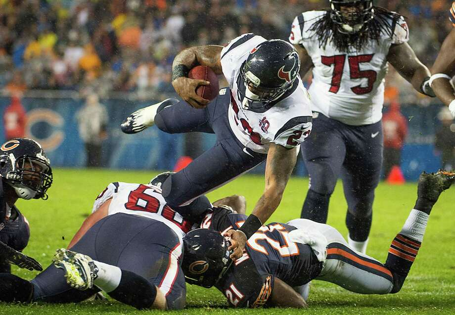 Texans running back Arian Foster (23) is upended by Chicago Bears strong safety Major Wright (21) during the first quarter. Photo: Smiley N. Pool, Houston Chronicle / © 2012  Houston Chronicle