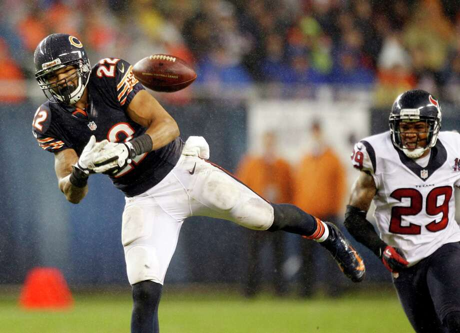 Bears running back Matt Forte (22) can't hold onto a pass as Houston Texans strong safety Glover Quin (29) defends during the second quarter. Photo: Brett Coomer, Houston Chronicle / © 2012  Houston Chronicle
