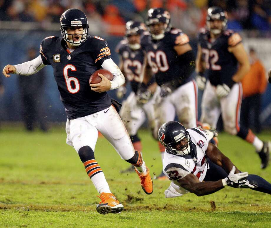 Bears quarterback Jay Cutler (6) scrambles past Texans inside linebacker Tim Dobbins (52) during the second quarter. Photo: Brett Coomer, Houston Chronicle / © 2012  Houston Chronicle