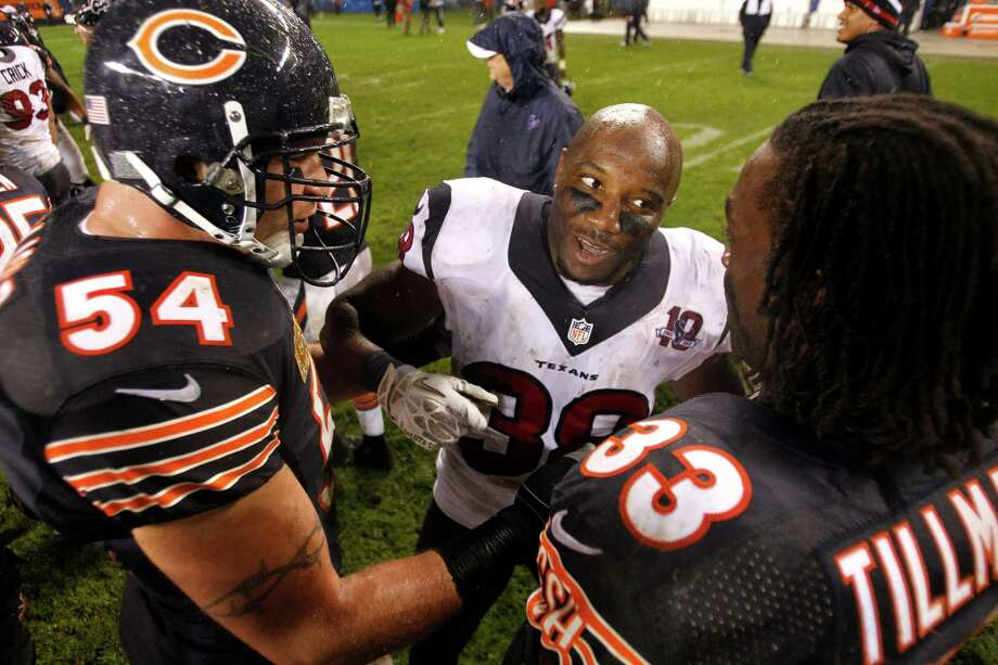 Texans free safety Danieal Manning (38) greets former teammates Bears middle linebacker Brian Urlacher (54) and  cornerback Charles Tillman (33) after the Texans win. Photo: Brett Coomer, Houston Chronicle / © 2012  Houston Chronicle