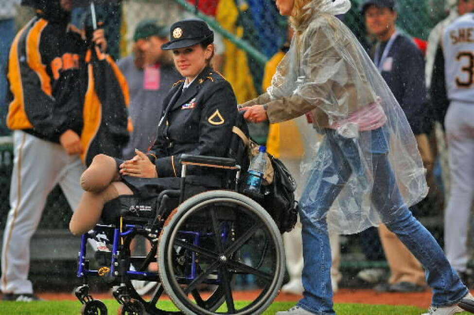 Marissa Strock was honored between innings at Doubleday Field in Cooperstown, NY during the annual Baseball Hall of Fame game in May, 2006. She and another injured soldier were presented with the EP Maxwell J. Schleifer Distinguished Service Awards.