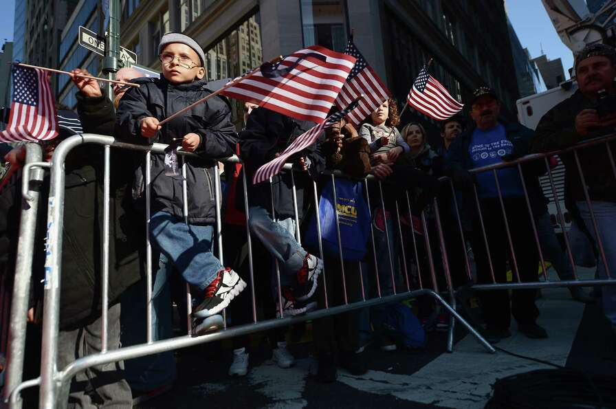 NEW YORK, NY - NOVEMBER 11:  Spectators watch the Veteran's Day Parade on November 11, 2012 in New Y