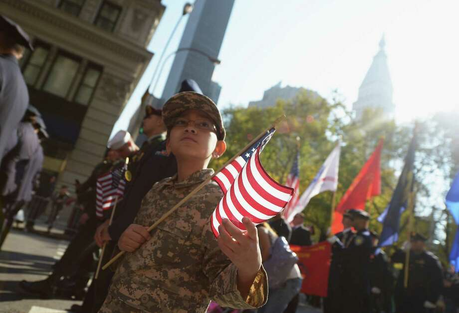 NEW YORK, NY - NOVEMBER 11: Carlos Gonzalez takes part in the Veteran's Day Parade with his mother, who is an active member of the U.S. Air Force on November 11, 2012 in New York City. Former Mayor Ed Koch is the grand marshal for the parade, which expects to draw thousands of spectators and is the commemoration of the 50th anniversary of the start of the Vietnam War. Photo: Michael Loccisano, Getty Images / 2012 Getty Images