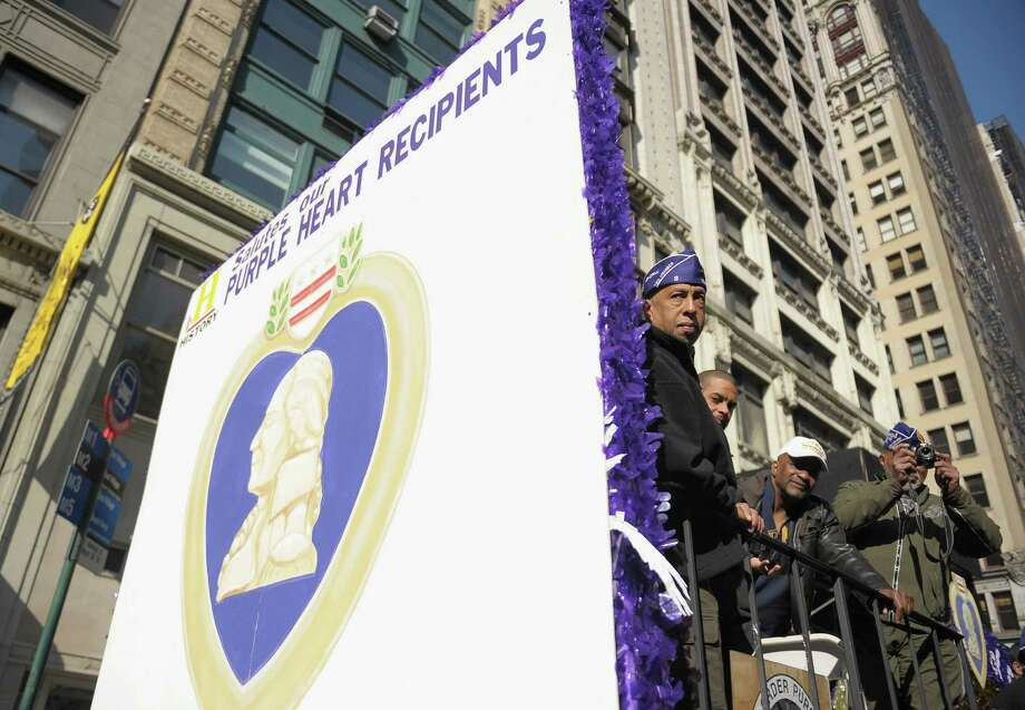 NEW YORK, NY - NOVEMBER 11:  Purple Heart recipients take part in the Veteran's Day Parade on November 11, 2012 in New York City. Former Mayor Ed Koch is the grand marshal for the parade, which expects to draw thousands of spectators and is the commemoration of the 50th anniversary of the start of the Vietnam War. Photo: Michael Loccisano, Getty Images / 2012 Getty Images