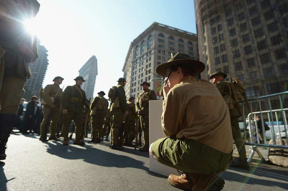 NEW YORK, NY - NOVEMBER 11:  People dressed as General Pershing's Doughboys take part in the Veteran's Day Parade on November 11, 2012 in New York City. Former Mayor Ed Koch is the grand marshal for the parade, which expects to draw thousands of spectators and is the commemoration of the 50th anniversary of the start of the Vietnam War. Photo: Michael Loccisano, Getty Images / 2012 Getty Images