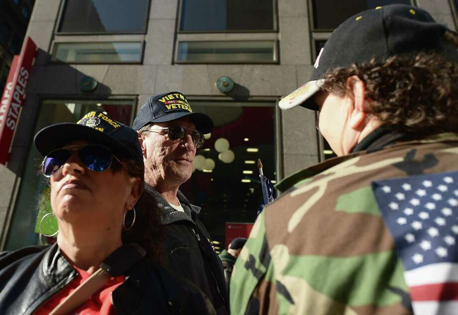 NEW YORK, NY - NOVEMBER 11:  Spectators attend the Veteran's Day Parade on November 11, 2012 in New York City. Former Mayor Ed Koch is the grand marshal for the parade, which expects to draw thousands of spectators and is the commemoration of the 50th anniversary of the start of the Vietnam War. Photo: Michael Loccisano, Getty Images / 2012 Getty Images