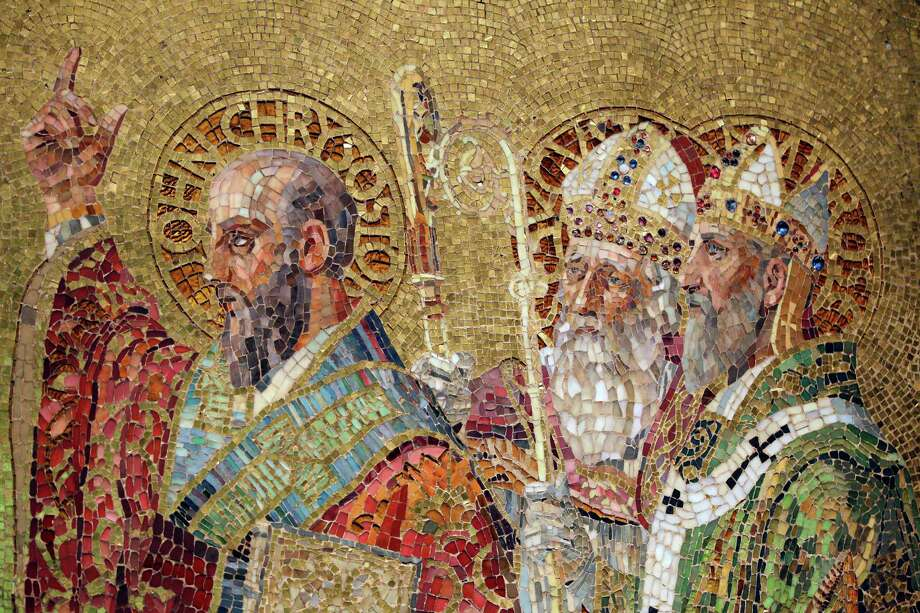 "In this Thursday, Oct. 25 2012 photo, a detail of the Father's of the Church mosaic is photographed while on display at the ""Louis C. Tiffany and the Art of Devotion"" exhibit at the Museum of Biblical Art in New York. Photo: Mary Altaffer, AP / AP"