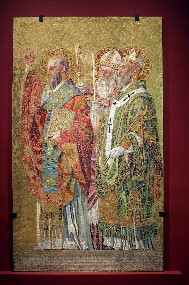 "In this Thursday, Oct. 25 2012 photo, the Father's of the Church mosaic hangs on display at the ""Louis C. Tiffany and the Art of Devotion"" exhibit at the Museum of Biblical Art in New York. Photo: Mary Altaffer, AP / AP"