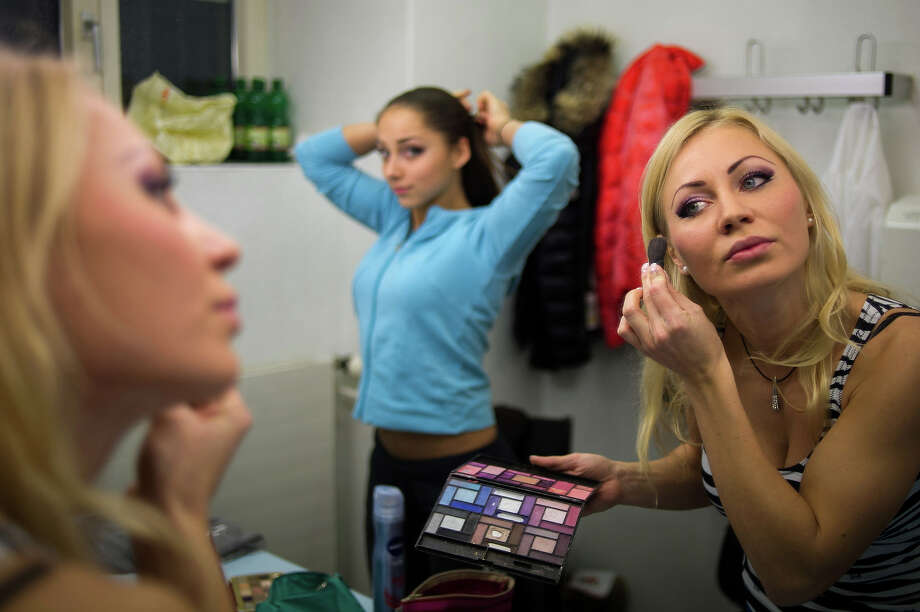 Competitors prepare prior to participating at the World Pole Dancing Championship 2012 held at the Volkshaus on November 10, 2012 in Zurich, Switzerland. The public's perception of pole dancing has recently changed to become a popular sport combining physical strength, technique and choreography. Photo: Harold Cunningham, Getty Images / 2012 Getty Images