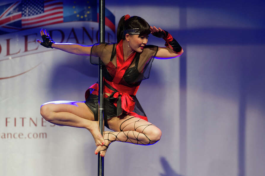 A competitor participates at the World Pole Dancing Championship 2012 held at the Volkshaus on No