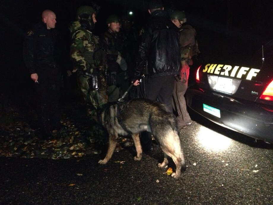 Investigators near the scene where an escapee from the Monroe prison was captured Sunday night. Photo: Handout Photo / King County Sheriff's Department