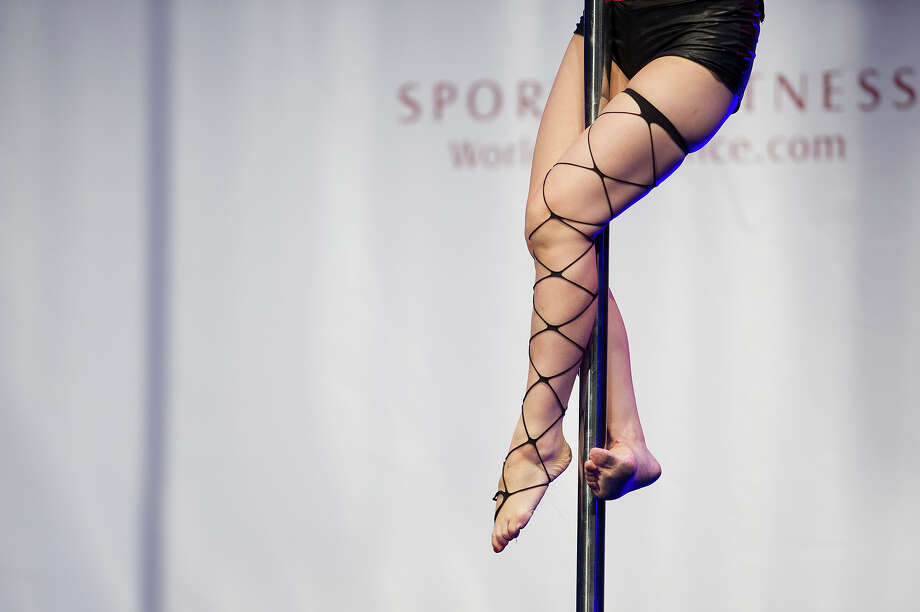 A detail of a competitor as she participates at the World Pole Dancing Championship 2012 held at the Volkshaus on November 10, 2012 in Zurich, Switzerland. The public's perception of pole dancing has recently changed to become a popular sport combining physical strength, technique and choreography. Photo: Harold Cunningham, Getty Images / 2012 Getty Images
