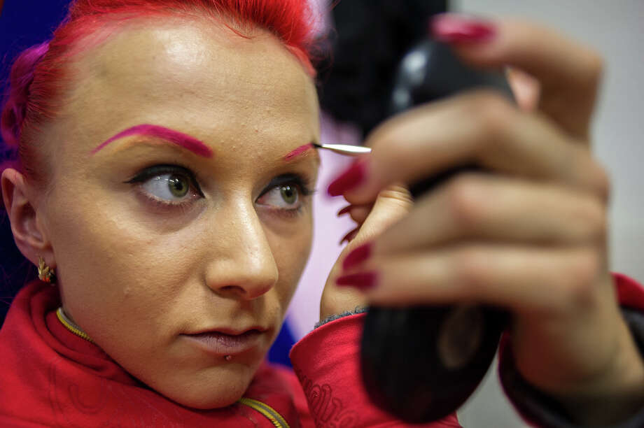 A competitor prepares prior to participating at the World Pole Dancing Championship 2012 held at the Volkshaus on November 10, 2012 in Zurich, Switzerland. The public's perception of pole dancing has recently changed to become a popular sport combining physical strength, technique and choreography. Photo: Harold Cunningham, Getty Images / 2012 Getty Images